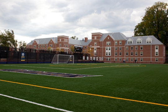 The front of the building from the other side of the soccer course